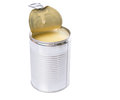 Condensed milk vii in tin cans over white background Royalty Free Stock Photo