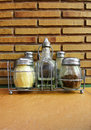 Condiment bottles, Italian restaurant Royalty Free Stock Photos