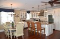 Condo kitchen and dining area Royalty Free Stock Photo