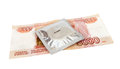 Condom and money on white background Royalty Free Stock Photography