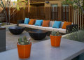 Condominium homes outdoor plaza patio and pool at early evening of an arizona project with bright orange turqoise cushioned Stock Photo
