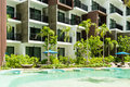 Condominium and swiming pool life of City people in modern town. Royalty Free Stock Photo