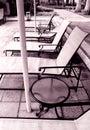 Condominium swimming pool furniture Royalty Free Stock Photo