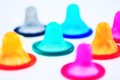 Condoms many colorful on white background Royalty Free Stock Photo