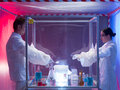 Conducting biohazard experiments in sterile chamber two scientists a men and a woman mixing chemicals a protection enclosure Royalty Free Stock Photography