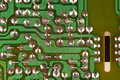 Conductive tracks on an electronic circuit board from modern device. Royalty Free Stock Photo