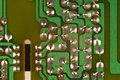 Conductive tracks on an electronic circuit board from radio engineering device. Royalty Free Stock Photo