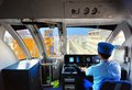 A conductor drives the okinawa monorail november in naha jp opened in it s currently the only public railway in okinawa and the Stock Image