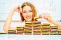 Confectionary beautiful businesswoman posing with cookies laid out in the form of diagrams business concept food industry Stock Photo