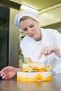 Confectioner, baker or pastry cook preparing cake