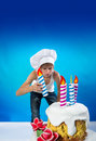 Confectioner with a cake funny decorates birthday Stock Photo