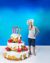 Confectioner with a cake little birthday Stock Photography