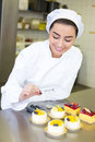 Confectioner preparing cakes at bakery or confectionery cake in Royalty Free Stock Images