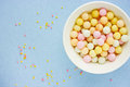 Confectionery food background beautiful sugar bubble sprinkle mi mix on blue selective focus blank space for text top view Royalty Free Stock Photography