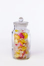 Confectionery. Jar of boiled sweets in wrappers isolated against Royalty Free Stock Photo