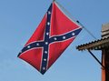 Confederate flag a flying from the roof of a building Royalty Free Stock Photo