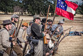 Confederates advance confederate troops toward the union army during a civil war reenactment in anderson california Royalty Free Stock Photo