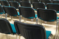 Conference chairs in business room, rows of comfortable seats in empty corporate presentation meeting office, detail, selective fo Royalty Free Stock Photo