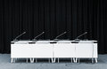 Conference microphones in a meeting room Royalty Free Stock Photo