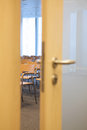 Conference room with ajar door Royalty Free Stock Photo