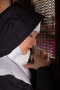 Confessing nun Stock Images