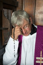 Confession box and priest Royalty Free Stock Photo