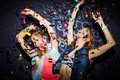 Confetti dancing two energetic girls in falling Royalty Free Stock Photography