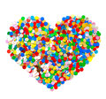 Confetti in heart shape. colorful background Royalty Free Stock Photo