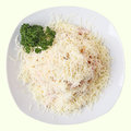 Confetti salad white dish with with ham chicken fillet pickled cucumber grated cheese and mayonnaise isolated on a white Stock Photos