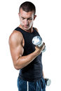 Confident athlete working out with dumbbells against white background Stock Image