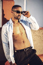 Confident attractive arab businessman undressing Royalty Free Stock Photos
