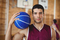 Confident basketball player holding a basketball Royalty Free Stock Photo