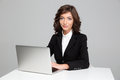 Confident beautiful business woman working using laptop curly young sitting and Stock Images
