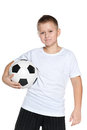 Confident boy with soccer ball a portrait of a young on the white background Stock Photos