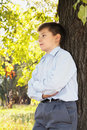 Confident boy at tree Stock Images