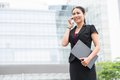 Confident business lady consulting her client by the phone Stock Photography