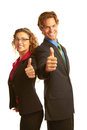 Confident business man giving the big thumbs up men in suit isolated on white background Stock Photo