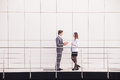 Confident business partners walking down in office building and talking. Royalty Free Stock Photo