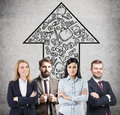 Confident business team members and startup arrow Royalty Free Stock Photo