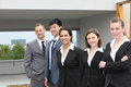 Confident business team standing together outdoors of diverse multiethnic young people Stock Photo