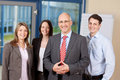 Confident business team standing together portrait of in office Royalty Free Stock Photo
