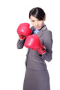 Confident business woman with boxing gloves Stock Photos