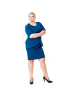Confident business woman with folded arms in dress Royalty Free Stock Photo
