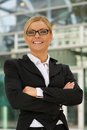 Confident business woman with glasses portrait of a smiling in the city Stock Photography