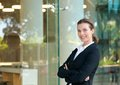 Confident business woman smiling by glass window Royalty Free Stock Photo