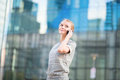 Confident business woman speaking on the phone young mobile Stock Image