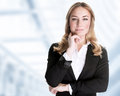Confident business woman standing in the office ceo of great corporate luxury career work place successful people concept Royalty Free Stock Photo
