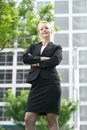 Confident business woman standing outdoors with arms crossed portrait of a Stock Image