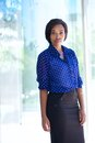 Confident business woman standing outside office building Royalty Free Stock Photo
