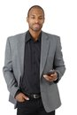 Confident businessman with cellphone Royalty Free Stock Photo